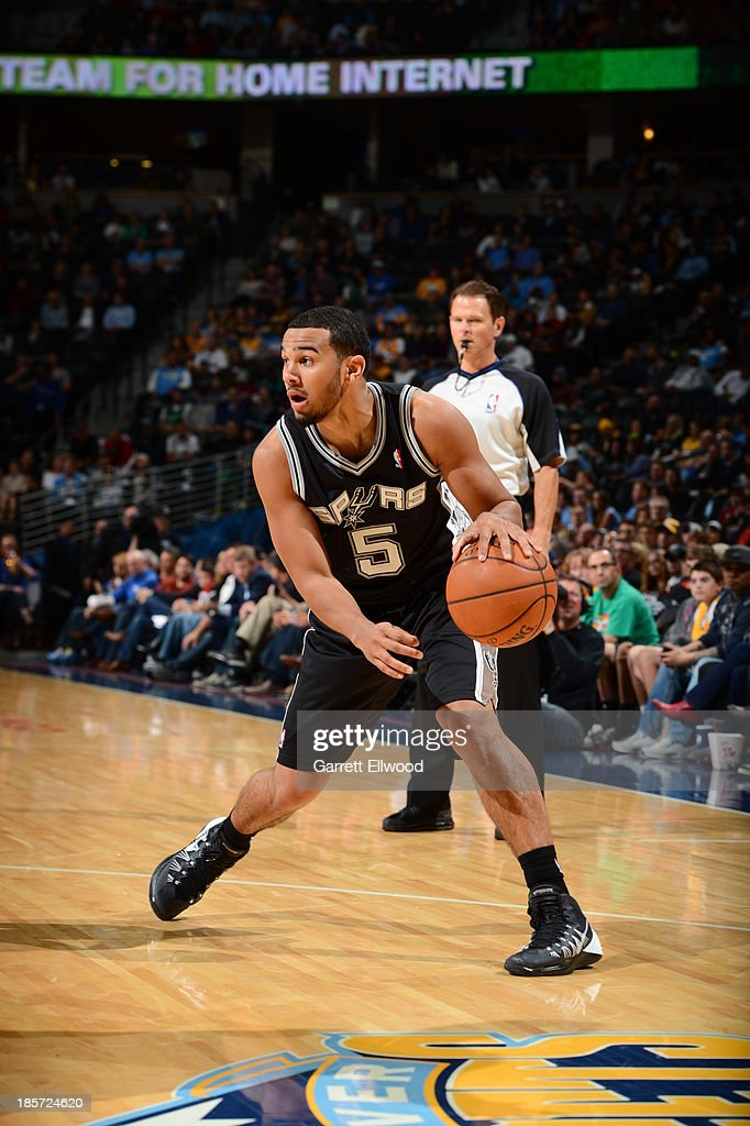 Cory Joseph #5 of the San Antonio Spurs dribbles during the game against the Denver Nuggets on October 14, 2013 at the Pepsi Center in Denver, Colorado.