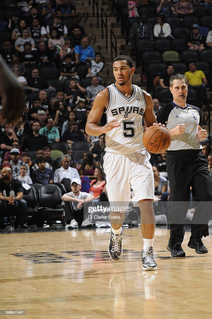 Cory Joseph #5 of the San Antonio Spurs dribbles the ball against the Minnesota Timberwolves on April 17, 2013 at the AT&T Center in San Antonio, Texas.