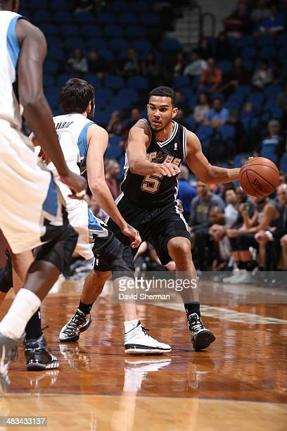 Cory Joseph of the San Antonio Spurs dribbles the ball against the Minnesota Timberwolves during the game on April 8 2014 at Target Center in...
