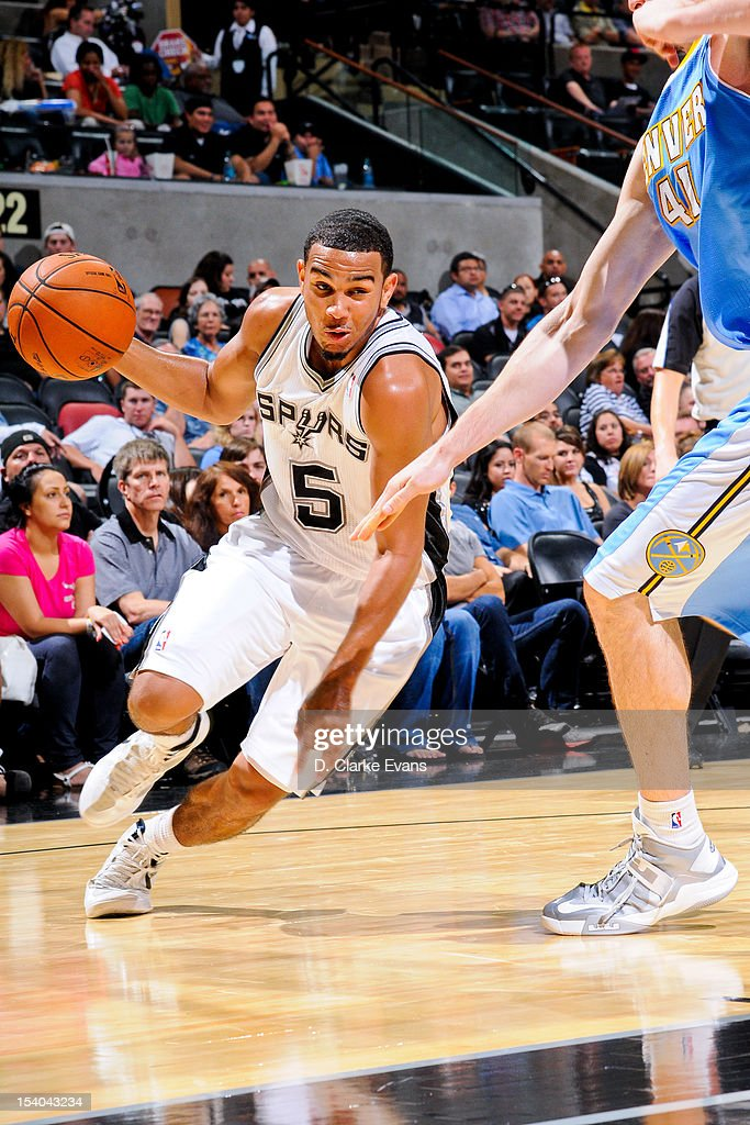 Cory Joseph #5 of the San Antonio Spurs drives against the Denver Nuggets during a pre-season game on October 12, 2012 at the AT&T Center in San Antonio, Texas.
