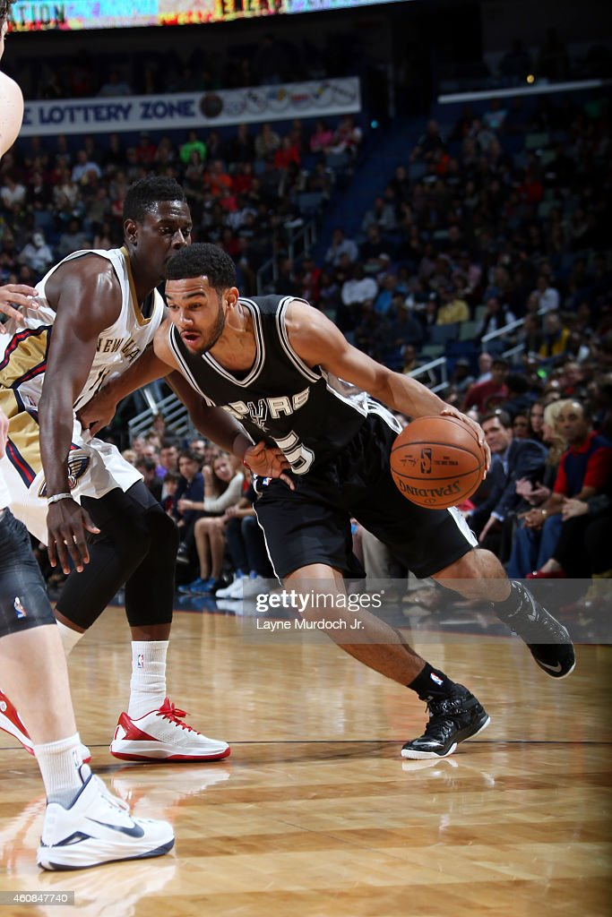 Cory Joseph #5 of the San Antonio Spurs drives against the New Orleans Pelicans on December 26, 2014 at Smoothie King Center in New Orleans, Louisiana.