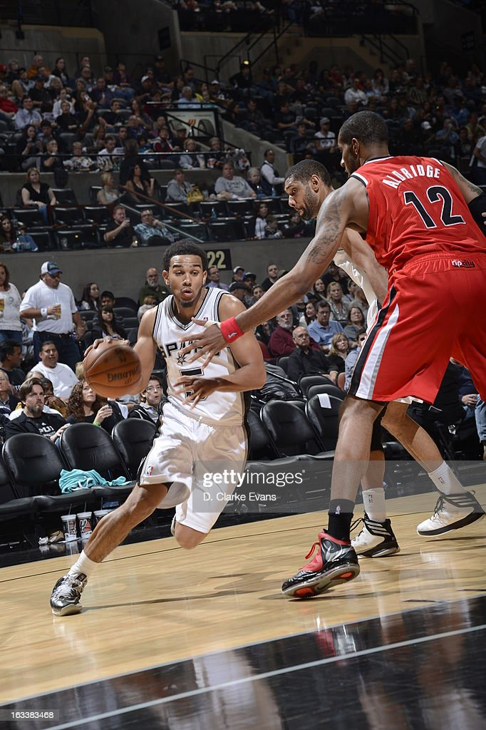 <a gi-track='captionPersonalityLinkClicked' href=/galleries/search?phrase=Cory+Joseph&family=editorial&specificpeople=5953537 ng-click='$event.stopPropagation()'>Cory Joseph</a> #5 of the San Antonio Spurs drives baseline against the Portland Trail Blazers on MARCH 8, 2013 at the AT&T Center in San Antonio, Texas.