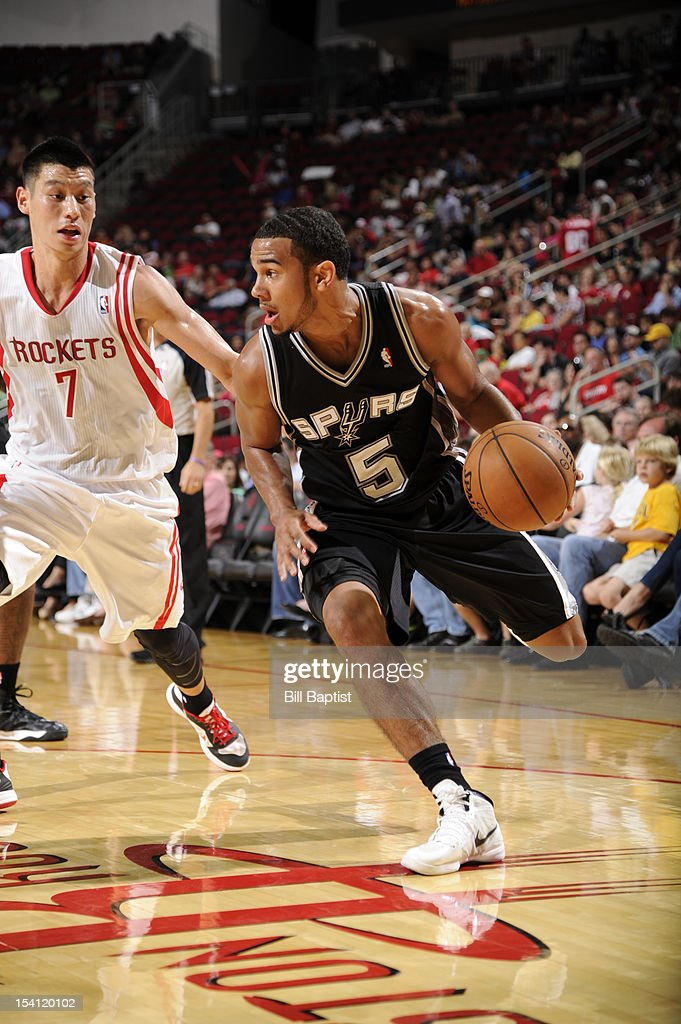 Cory Joseph #5 of the San Antonio Spurs drives the ball against <a gi-track='captionPersonalityLinkClicked' href=/galleries/search?phrase=Jeremy+Lin&family=editorial&specificpeople=6669516 ng-click='$event.stopPropagation()'>Jeremy Lin</a> #7 of the Houston Rockets during a pre-season game on October 14, 2012 at the Toyota Center in Houston, Texas.
