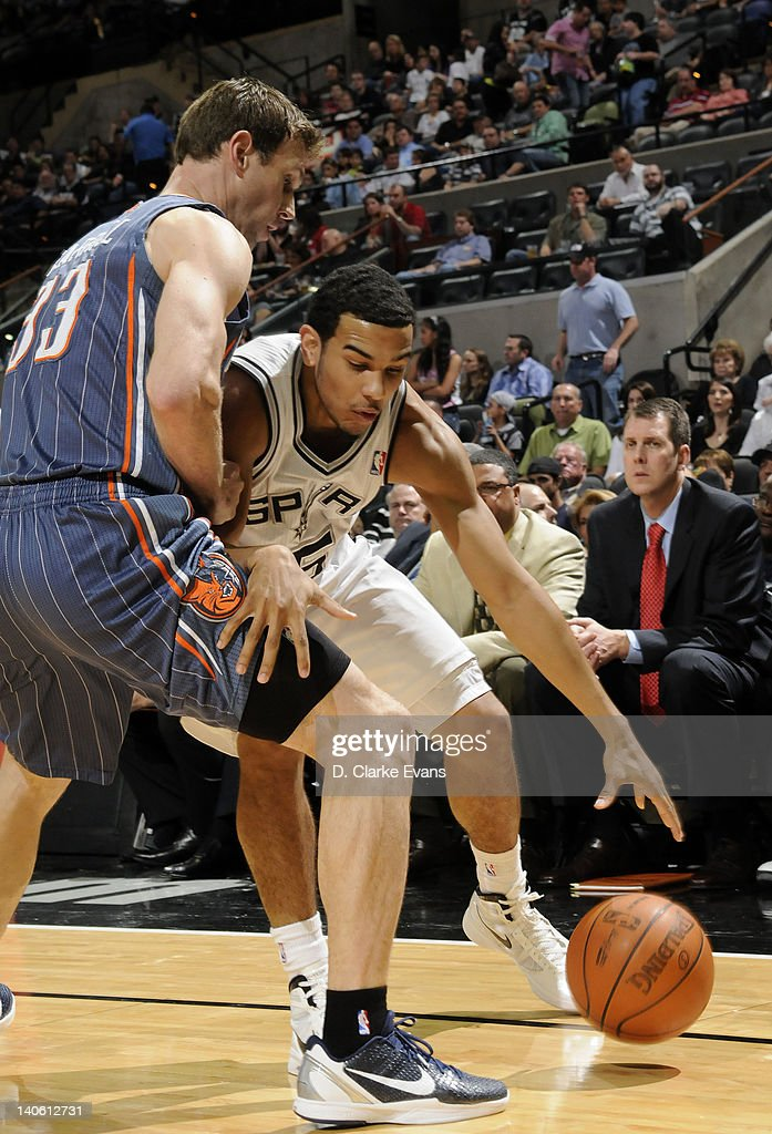 Cory Joseph #5 of the San Antonio Spurs drives to the basket against <a gi-track='captionPersonalityLinkClicked' href=/galleries/search?phrase=Matt+Carroll+-+Basketball+Player&family=editorial&specificpeople=213200 ng-click='$event.stopPropagation()'>Matt Carroll</a> #33 of the Charlotte Bobcats during the game at the AT&T Center on March 2, 2012 in San Antonio, Texas.