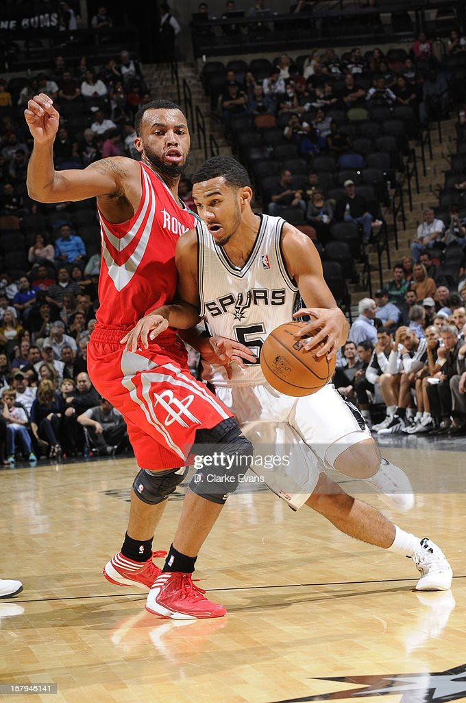 <a gi-track='captionPersonalityLinkClicked' href=/galleries/search?phrase=Cory+Joseph&family=editorial&specificpeople=5953537 ng-click='$event.stopPropagation()'>Cory Joseph</a> #5 of the San Antonio Spurs drives to the basket against <a gi-track='captionPersonalityLinkClicked' href=/galleries/search?phrase=Daequan+Cook&family=editorial&specificpeople=3847493 ng-click='$event.stopPropagation()'>Daequan Cook</a> #14 of the Houston Rockets on December 7, 2012 at the AT&T Center in San Antonio, Texas.