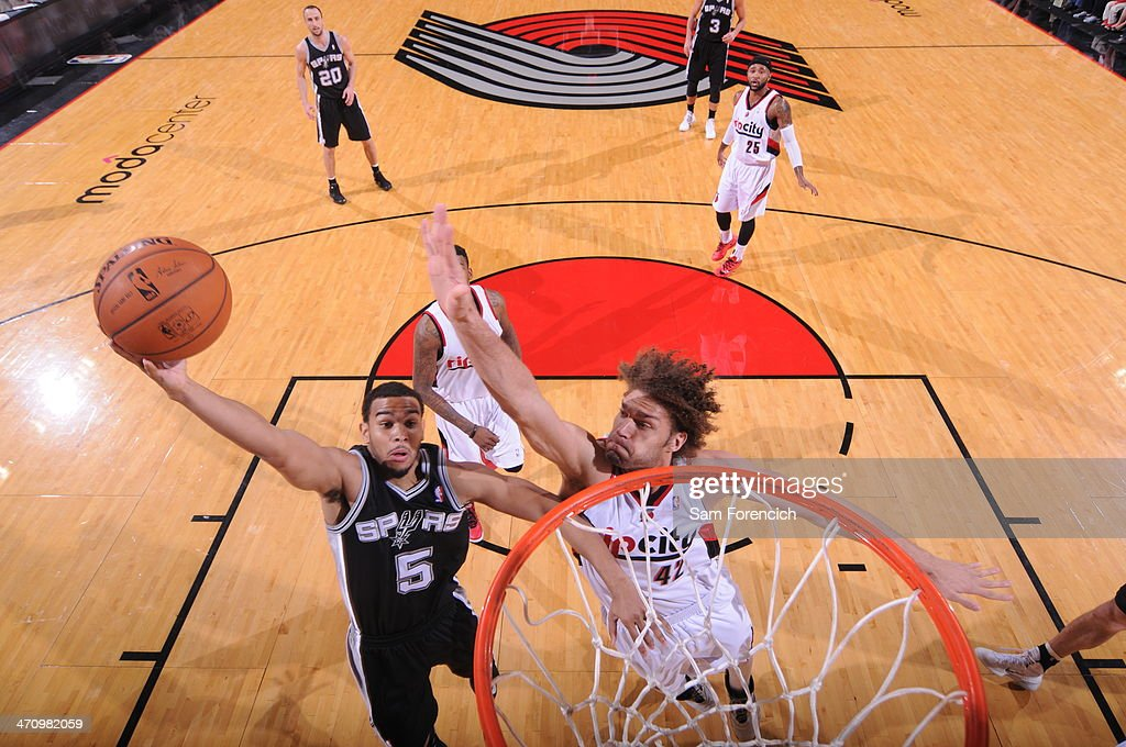 Cory Joseph #5 of the San Antonio Spurs drives to the basket against the Portland Trail Blazers on February 19, 2014 at the Moda Center Arena in Portland, Oregon.