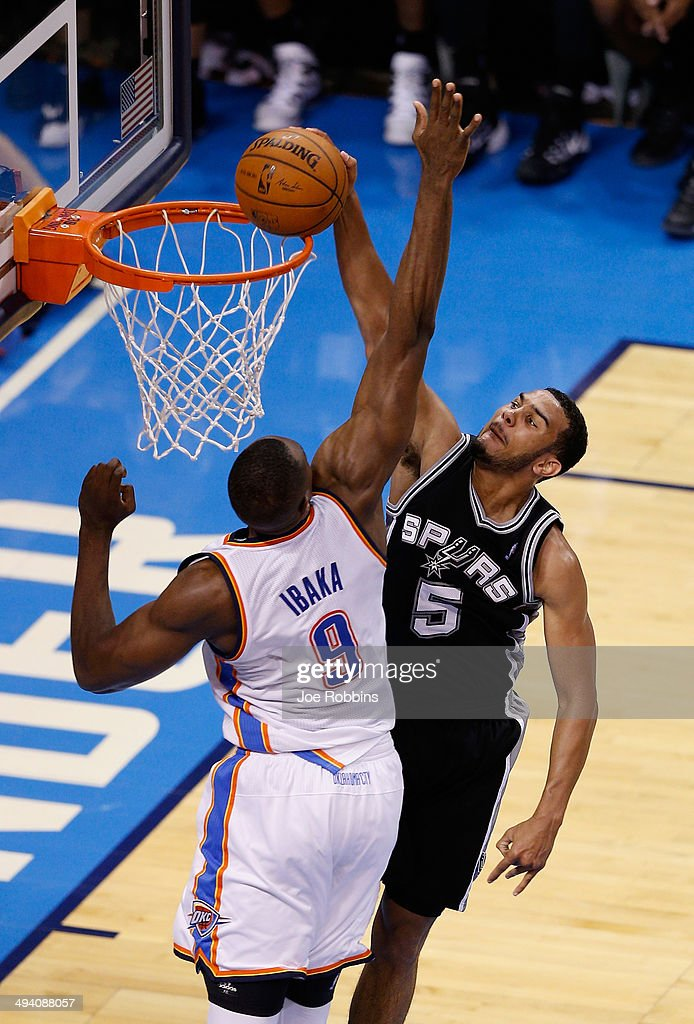 Cory Joseph #5 of the San Antonio Spurs dunks on Serge Ibaka #9 of the Oklahoma City Thunder in the second half during Game Four of the Western Conference Finals of the 2014 NBA Playoffs at Chesapeake Energy Arena on May 27, 2014 in Oklahoma City, Oklahoma.
