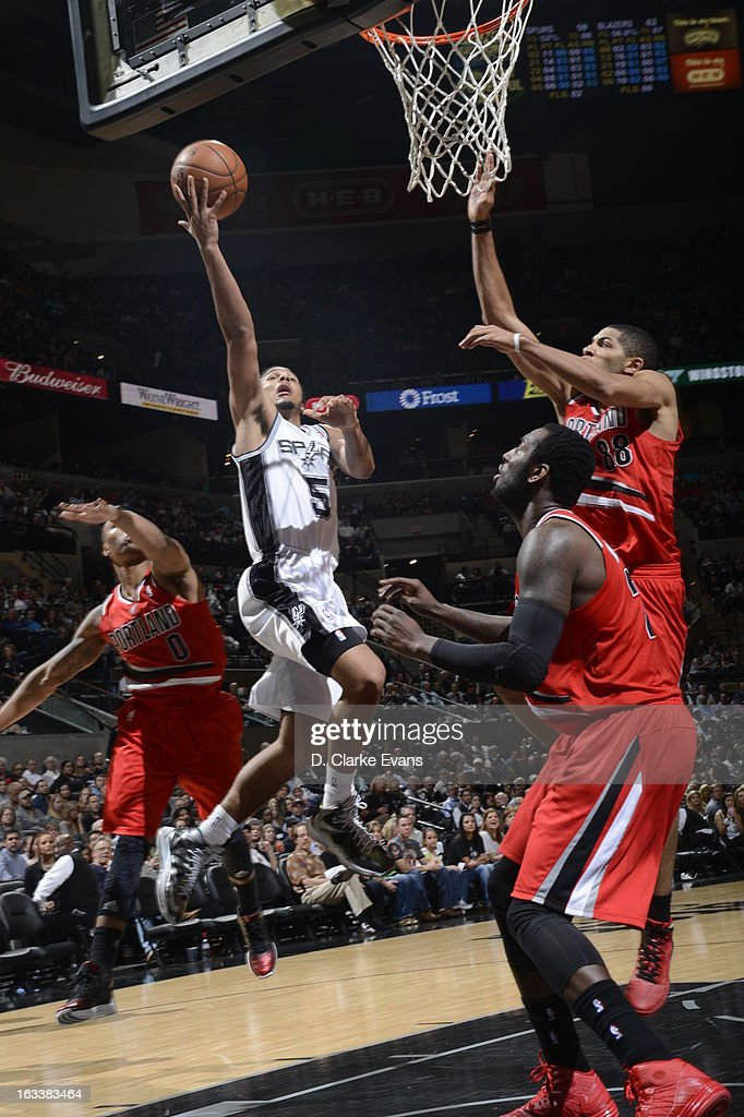 <a gi-track='captionPersonalityLinkClicked' href=/galleries/search?phrase=Cory+Joseph&family=editorial&specificpeople=5953537 ng-click='$event.stopPropagation()'>Cory Joseph</a> #5 of the San Antonio Spurs goes up for the layup against the Portland Trail Blazers on MARCH 8, 2013 at the AT&T Center in San Antonio, Texas.