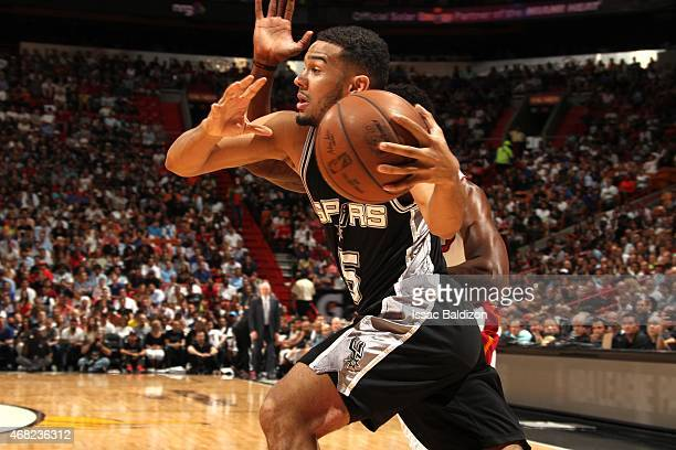 Cory Joseph of the San Antonio Spurs handles the ball against the Miami Heat on March 31 2015 at American Airlines Arena in Miami Florida NOTE TO...