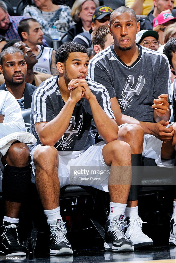 Cory Joseph #5 of the San Antonio Spurs looks on from the bench as his teammates play against the Utah Jazz on March 22, 2013 at the AT&T Center in San Antonio, Texas.