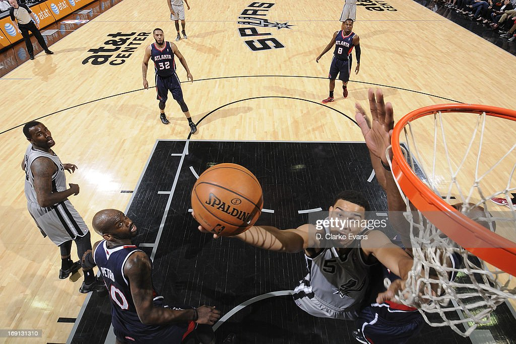 <a gi-track='captionPersonalityLinkClicked' href=/galleries/search?phrase=Cory+Joseph&family=editorial&specificpeople=5953537 ng-click='$event.stopPropagation()'>Cory Joseph</a> #5 of the San Antonio Spurs shoots a layup against the Atlanta Hawks on April 6, 2013 at the AT&T Center in San Antonio, Texas.