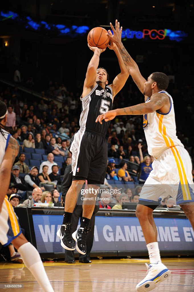 Cory Joseph #5 of the San Antonio Spurs shoots against Jeremy Tyler #3 of the Golden State Warriors on April 26, 2012 at Oracle Arena in Oakland, California.