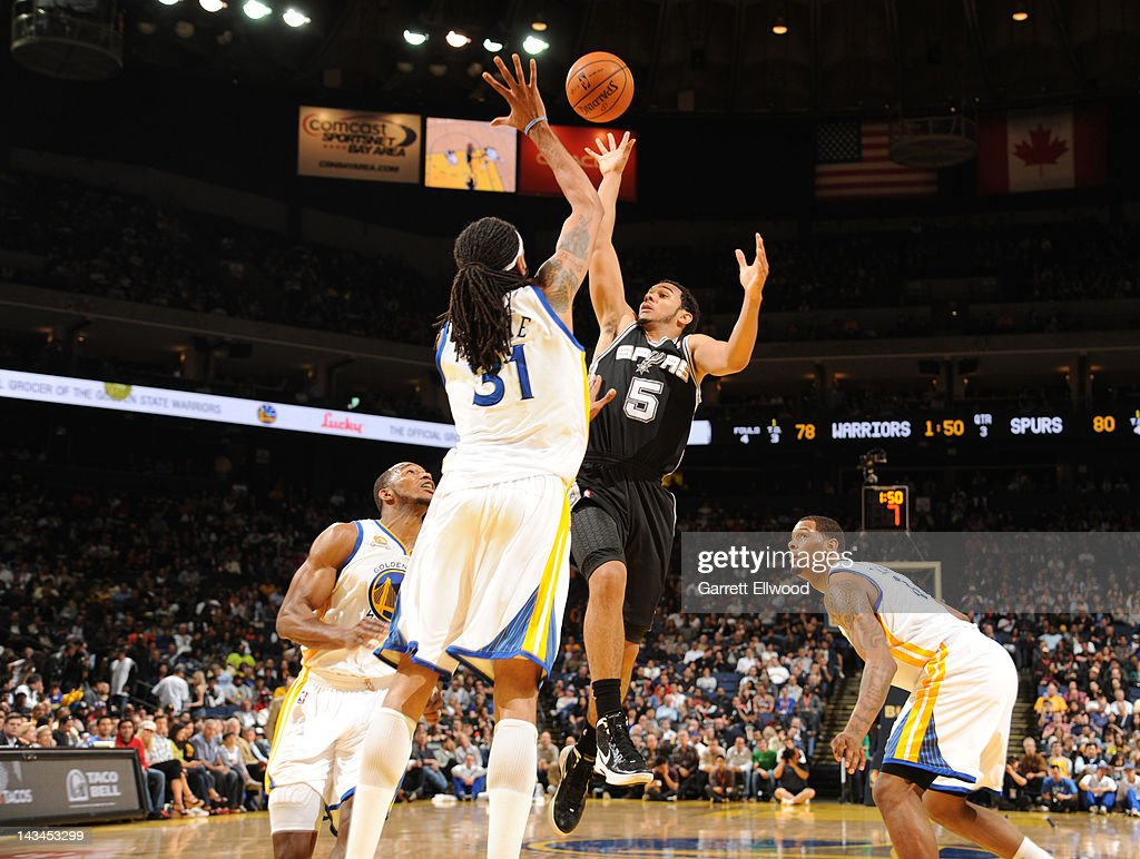 Cory Joseph #5 of the San Antonio Spurs shoots against <a gi-track='captionPersonalityLinkClicked' href=/galleries/search?phrase=Mikki+Moore&family=editorial&specificpeople=202632 ng-click='$event.stopPropagation()'>Mikki Moore</a> #31 of the Golden State Warriors on April 26, 2012 at Oracle Arena in Oakland, California.