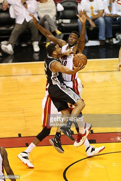 Cory Joseph of the San Antonio Spurs shoots against the Miami Heat during Game Four of the 2014 NBA Finals at American Airlines Arena on June 12 2014...