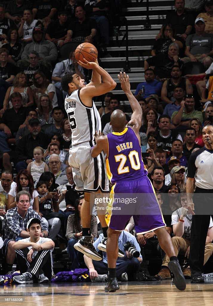 Cory Joseph #5 of the San Antonio Spurs shoots the ball against Jodie Meeks #20 of the Los Angeles Lakers during the Game One of the Western Conference Quarterfinals between the Los Angeles Lakers and the San Antonio Spurs on April 21, 2013 at the AT&T Center in San Antonio, Texas.