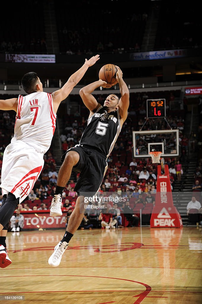 Cory Joseph #5 of the San Antonio Spurs shoots the ball over <a gi-track='captionPersonalityLinkClicked' href=/galleries/search?phrase=Jeremy+Lin&family=editorial&specificpeople=6669516 ng-click='$event.stopPropagation()'>Jeremy Lin</a> #7 of the Houston Rockets during a pre-season game on October 14, 2012 at the Toyota Center in Houston, Texas.