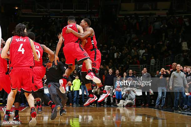 Cory Joseph of the Toronto Raptors and his teammates celebrate after hitting a game winning shot against the Washington Wizards on November 28 2015...
