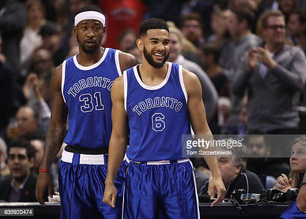 Cory Joseph of the Toronto Raptors and Terrence Ross against the Minnesota Timberwolves during NBA game action at Air Canada Centre on December 8...