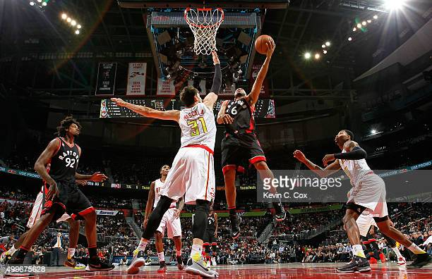 Cory Joseph of the Toronto Raptors attacks the basket against Mike Muscala of the Atlanta Hawks at Philips Arena on December 2 2015 in Atlanta...
