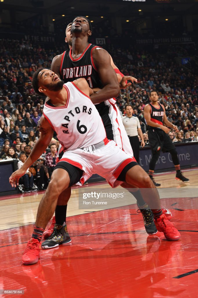 Cory Joseph #6 of the Toronto Raptors boxes out against Noah Vonleh #21 of the Portland Trail Blazers on February 26, 2017 at the Air Canada Centre in Toronto, Ontario, Canada.