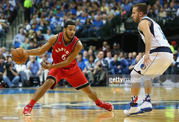 Cory Joseph of the Toronto Raptors dribbles the ball against JJ Barea of the Dallas Mavericks at American Airlines Center on November 3 2015 in...