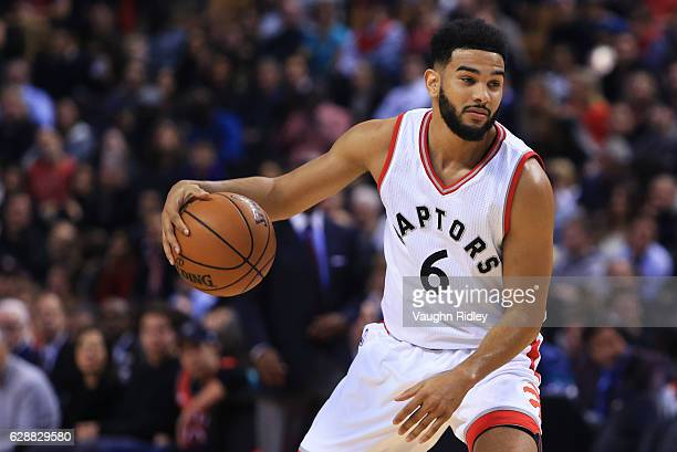 Cory Joseph of the Toronto Raptors dribbles the ball during the first half of an NBA game at Air Canada Centre against the Atlanta Hawks on December...