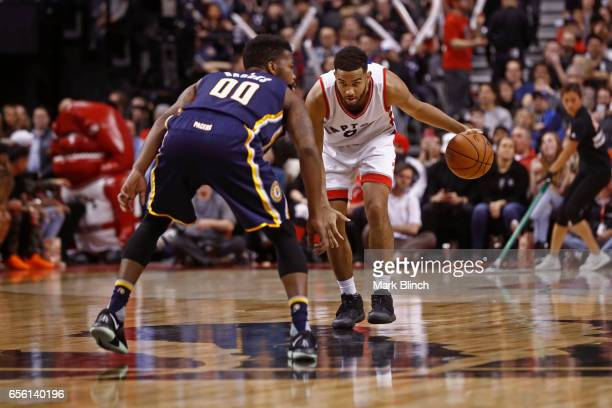 Cory Joseph of the Toronto Raptors dribbles the ball up court against the Indiana Pacers on March 19 2017 at Air Canada Centre in Toronto Ontario...