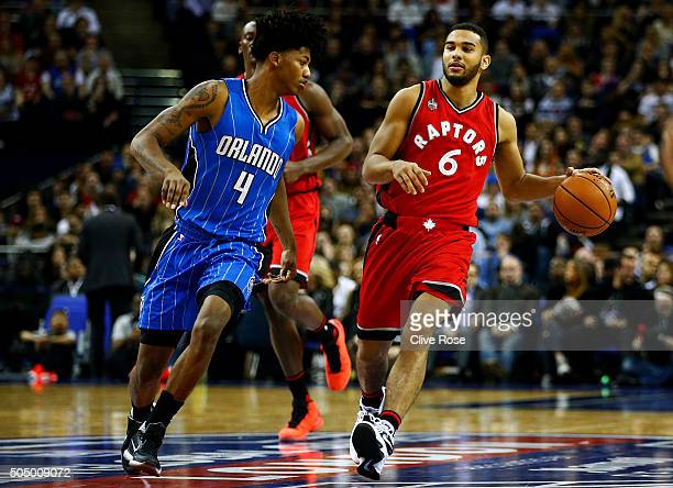 Cory Joseph of the Toronto Raptors dribbles towards Elfrid Payton of the Orlando Magic during the 2016 NBA Global Games London match between Toronto...