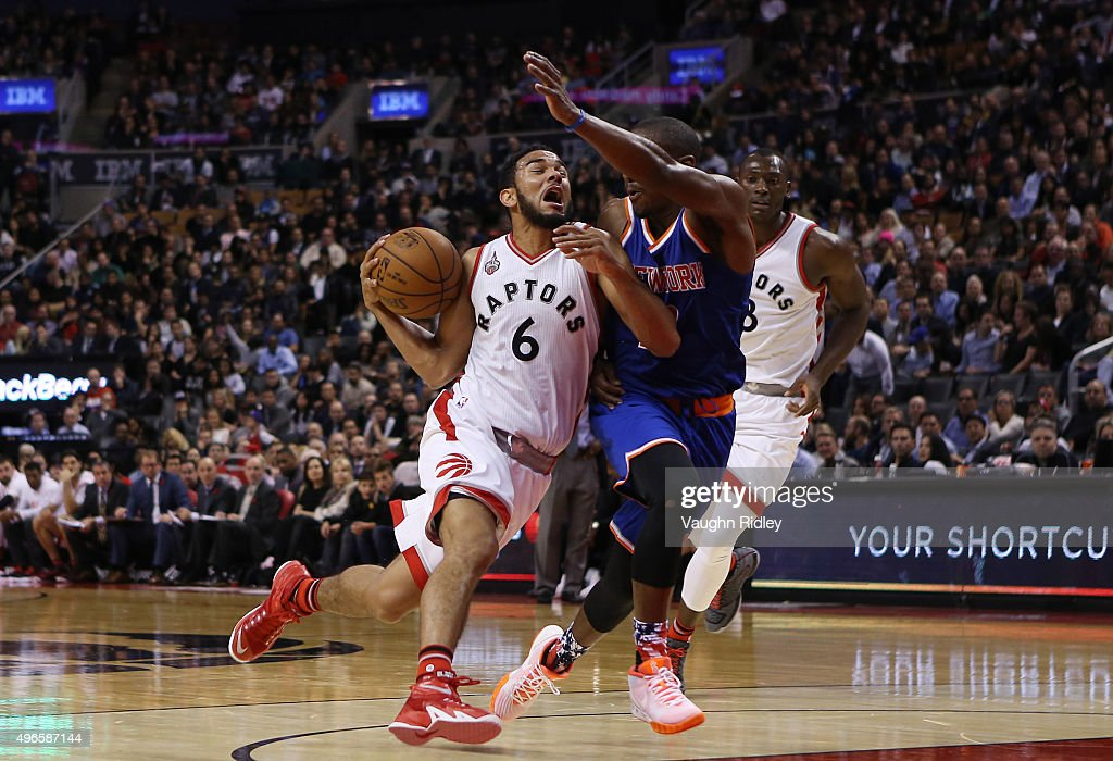 Cory Joseph of the Toronto Raptors drives against Langston Galloway of the New York Knicks defends during an NBA game at the Air Canada Centre on...