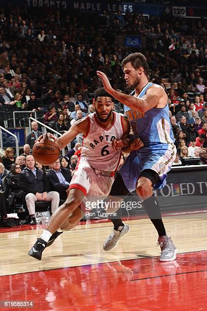 Cory Joseph of the Toronto Raptors drives to the basket against Danilo Gallinari of the Denver Nuggets during a game on October 31 2016 at the Air...