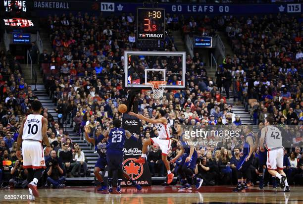 Cory Joseph of the Toronto Raptors passes the ball during the first half of an NBA game against the Dallas Mavericks at Air Canada Centre on March 13...
