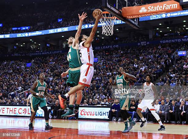 Cory Joseph of the Toronto Raptors shoots the ball as Tyler Zeller of the Boston Celtics defends during the first half of an NBA game at the Air...