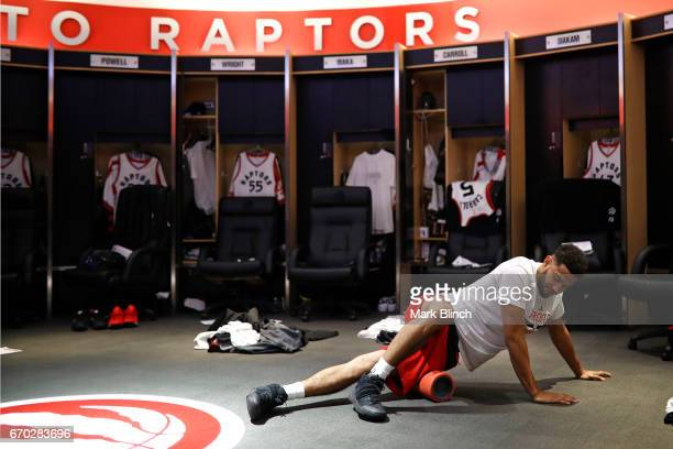 Cory Joseph of the Toronto Raptors stretches before the game against the Milwaukee Bucks on April 15 2017 during Game One of Round One of the 2017...