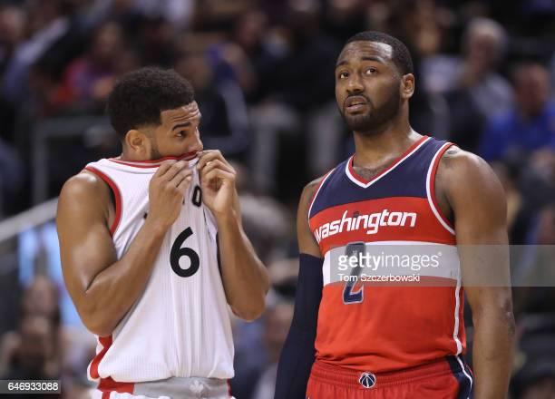 Cory Joseph of the Toronto Raptors talks to John Wall of the Washington Wizards during NBA game action at Air Canada Centre on March 1 2017 in...