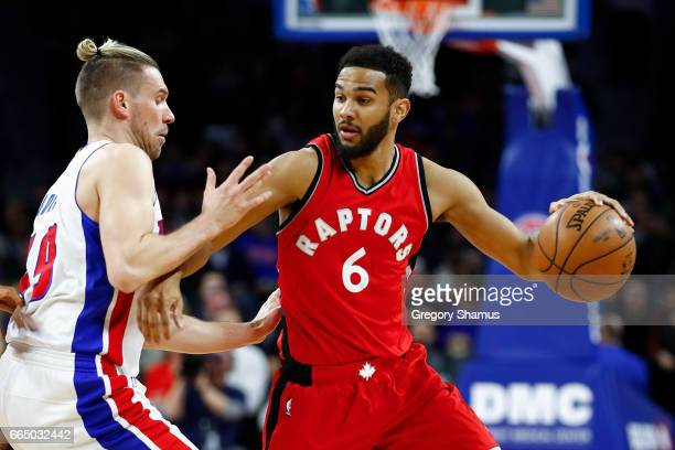Cory Joseph of the Toronto Raptors tries to drive around Beno Udrih of the Detroit Pistons during the first half at the Palace of Auburn Hills on...