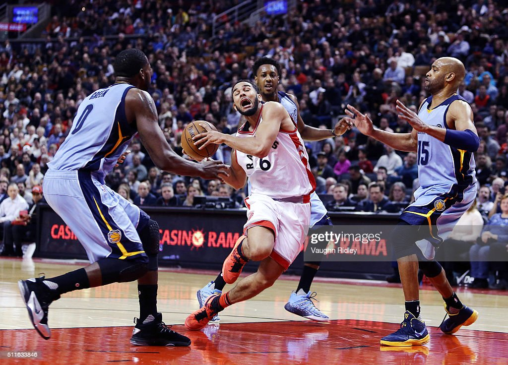 Cory Joseph #6 of the Toronto Raptors trips as he dribbles the ball during the second half of an NBA game against the Memphis Grizzlies at the Air Canada Centre on February 21, 2016 in Toronto, Ontario, Canada.