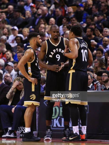 Cory Joseph Serge Ibaka and DeMar DeRozan of the Toronto Raptors talk during the second half of an NBA game against the Oklahoma City Thunder at Air...