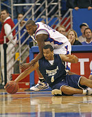 Cory Lowe of Northern Colorado fights off Darnell Jackson of Kansas for the ball during 1st half action at Allen Fieldhouse in Lawrence Kansas on...