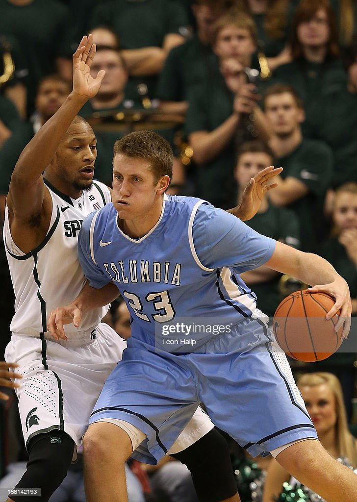 Cory Osetkowski #23 of the Columbia Lions drives the ball to the basket as <a gi-track='captionPersonalityLinkClicked' href=/galleries/search?phrase=Adreian+Payne&family=editorial&specificpeople=7367769 ng-click='$event.stopPropagation()'>Adreian Payne</a> #5 of the Michigan State Spartans defends during the second half of the game at Breslin Center on November 15, 2013 in East Lansing, Michigan. Michigan State defeated Columbia 62-53.
