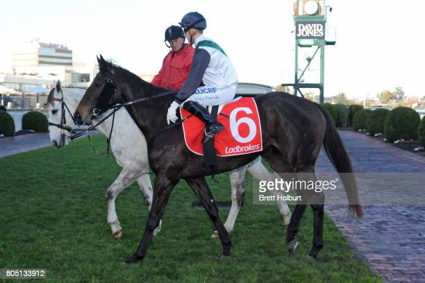 Cory Parish returns to the mounting yard on Sullivan Bay after winning Tile Importer Handicap at Caulfield Racecourse on July 01 2017 in Caulfield...