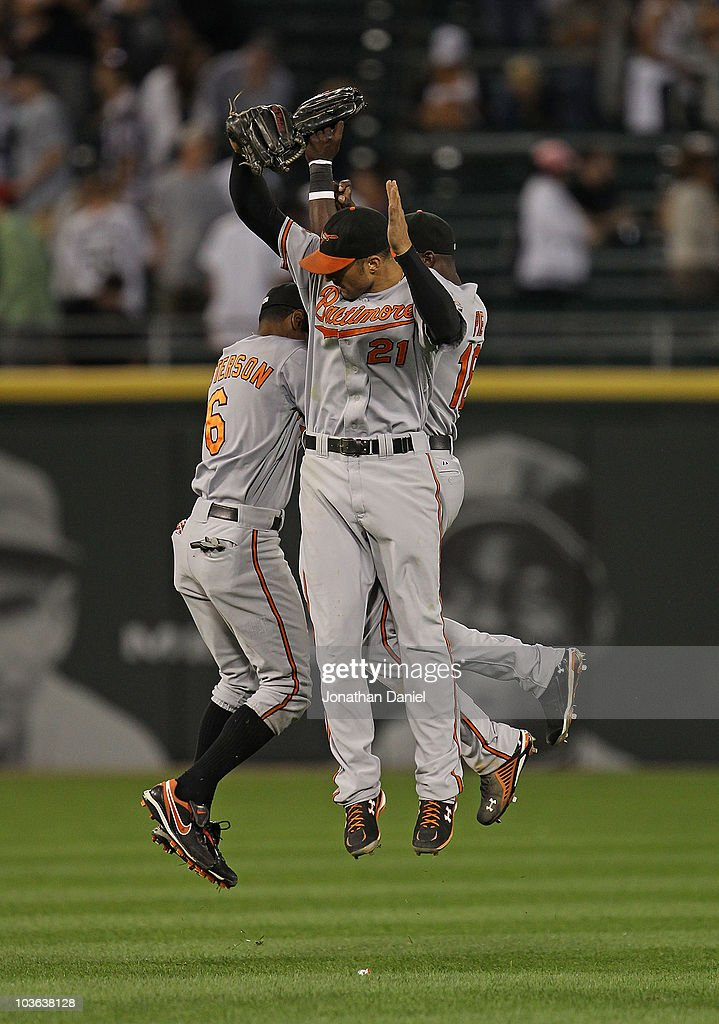 Cory Patterson Nick Markakis and Felix Pie of the Baltimore Orioles leap in celebration after a win over the Chicago White Sox at US Cellular Field...