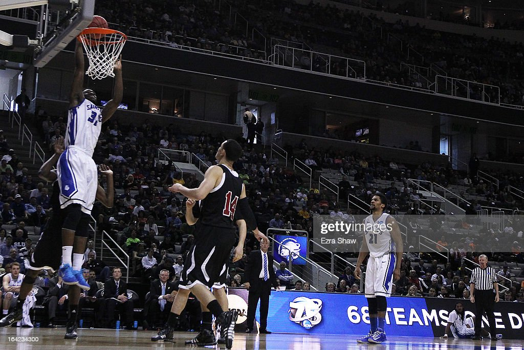 Cory Remekun #32 of the Saint Louis Billikens dunks against the New Mexico State Aggies in the second half during the second round of the 2013 NCAA Men's Basketball Tournament at HP Pavilion on March 21, 2013 in San Jose, California.