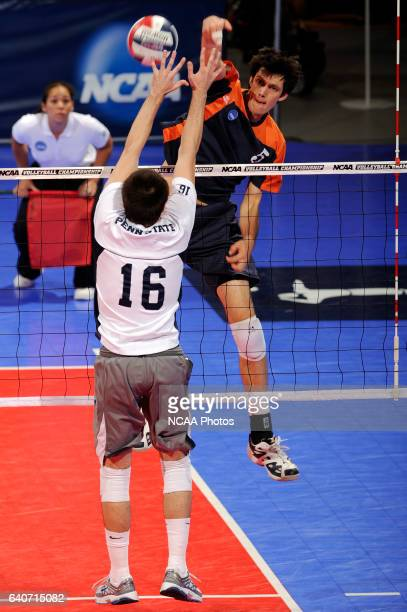 Cory Riecks of Pepperdine University hits a kill over Luke Murray of Penn State University during the Division I Mens Volleyball Championship held at...