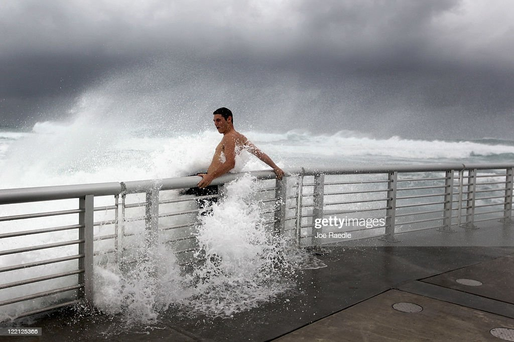 Cory Ritz braces himself as a wave bursts onto a pier at the Boynton Beach inlet on August 25, 2011 in Boynton Beach, Florida. Hurricane Irene is moving over the Bahamas and could still be a major storm as it approaches the North Carolina coast the morning of August 27.