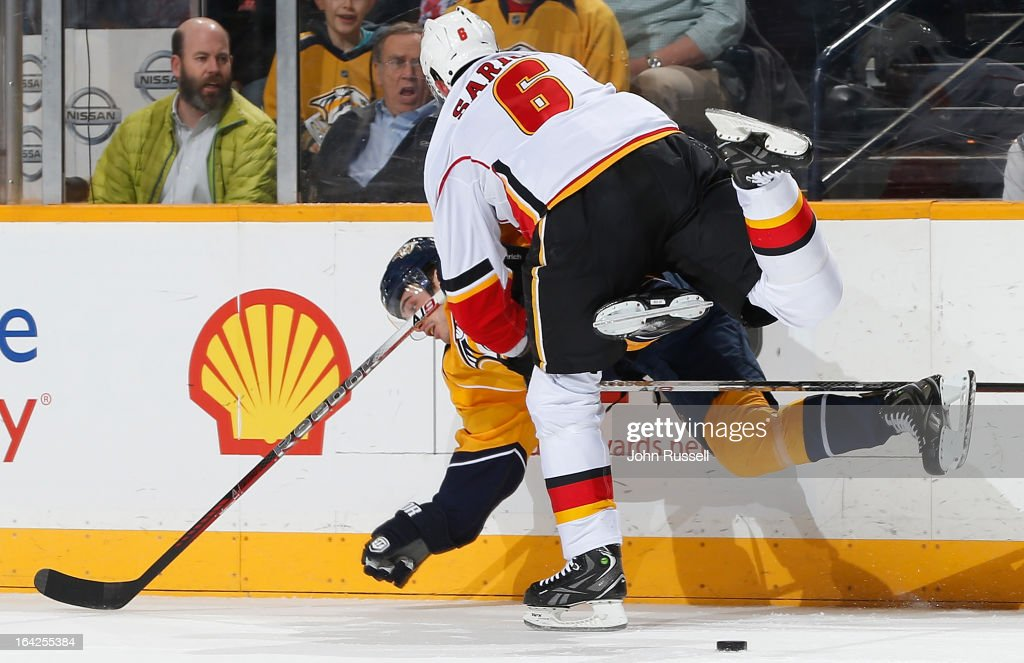 <a gi-track='captionPersonalityLinkClicked' href=/galleries/search?phrase=Cory+Sarich&family=editorial&specificpeople=204153 ng-click='$event.stopPropagation()'>Cory Sarich</a> #6 of the Calgary Flames upends Taylor Beck #56 of the Nashville Predators during an NHL game at the Bridgestone Arena on March 21, 2013 in Nashville, Tennessee.