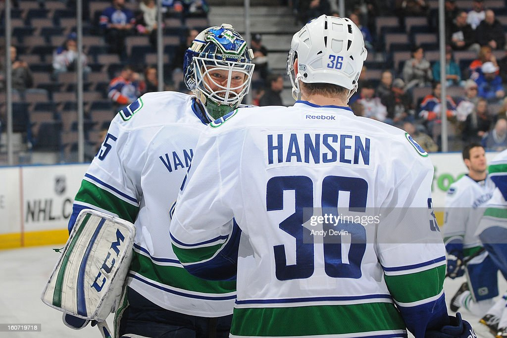 Cory Schneider #35 and Jannik Hansen #35 of the Vancouver Canucks warm up prior to a game against the Edmonton Oilers on February 4, 2013 at Rexall Place in Edmonton, Alberta, Canada.