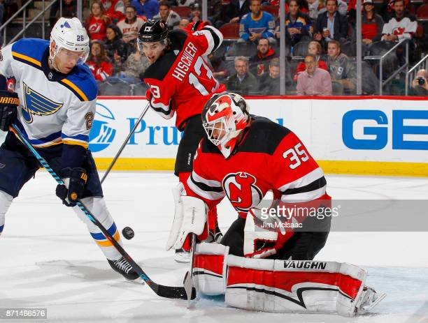 Cory Schneider and Nico Hischier of the New Jersey Devils defend against Paul Stastny of the St Louis Blues during the third period on November 7...