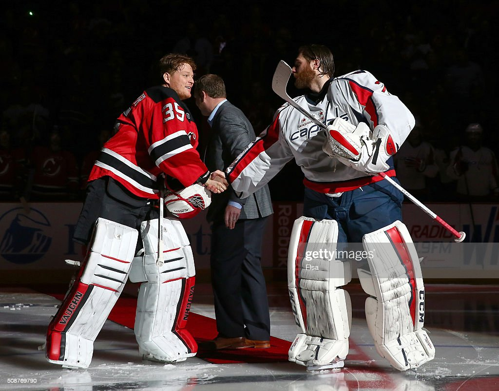 <a gi-track='captionPersonalityLinkClicked' href=/galleries/search?phrase=Cory+Schneider&family=editorial&specificpeople=696908 ng-click='$event.stopPropagation()'>Cory Schneider</a> #35 of the Devils and <a gi-track='captionPersonalityLinkClicked' href=/galleries/search?phrase=Braden+Holtby&family=editorial&specificpeople=5370964 ng-click='$event.stopPropagation()'>Braden Holtby</a> #70 of the Washington Capitals shake hands after a ceremonial puck drop by former Devils goaltender <a gi-track='captionPersonalityLinkClicked' href=/galleries/search?phrase=Martin+Brodeur&family=editorial&specificpeople=201594 ng-click='$event.stopPropagation()'>Martin Brodeur</a> before the game on February 6, 2016 at Prudential Center in Newark, New Jersey.