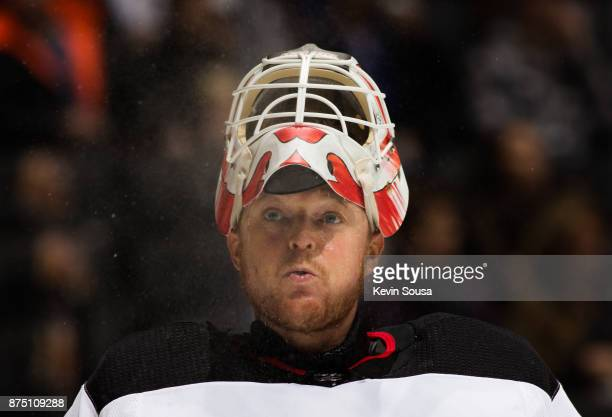 Cory Schneider of the New Jersey Devils blows water out of his mouth during a break in play in the second period against the Toronto Maple Leafs at...