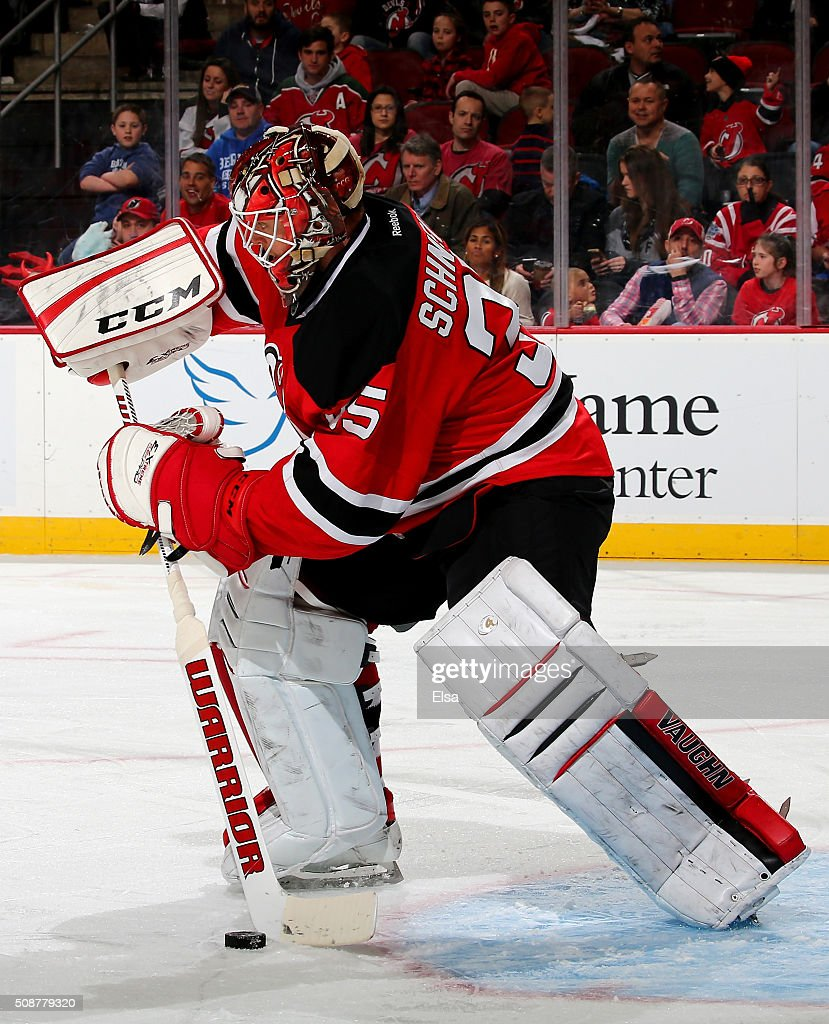 <a gi-track='captionPersonalityLinkClicked' href=/galleries/search?phrase=Cory+Schneider&family=editorial&specificpeople=696908 ng-click='$event.stopPropagation()'>Cory Schneider</a> #35 of the New Jersey Devils clears the puck in the third period against the Washington Capitals on February 6, 2016 at Prudential Center in Newark, New Jersey.The Washington Capitals defeated the New Jersey Devils 3-2 in an overtime shootout.